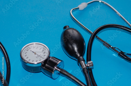Aneroid blood pressure kit for pressure measurement on a blue background Wallpaper Mural