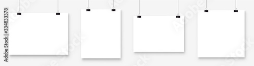 Fotografía White blank poster template hanging on wall