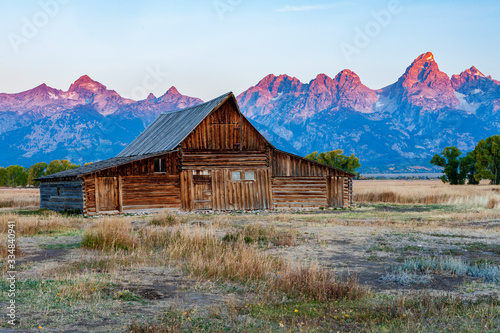 Historic mormon barn in front of the Grand Tetons at sunrise, Grand Teton National Park, Wyoming Canvas-taulu