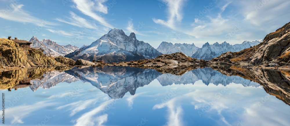 Fototapeta Reflection of Mont Blanc on lake in high mountains in the French Alps, Chamonix.