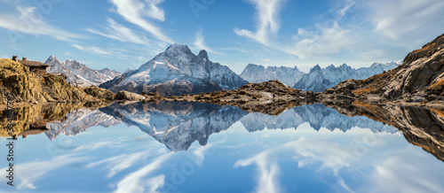 Carta da parati Reflection of Mont Blanc on lake in high mountains in the French Alps, Chamonix