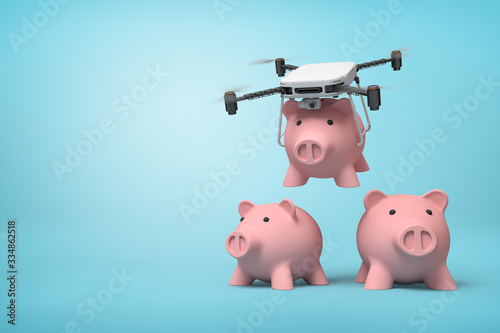 3d rendering of quadcopter carrying pink piggy bank and putting it down to two identic piggy banks standing on light blue background with copy space Canvas