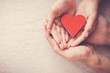 hands holding red heart, heart health, donation, volunteer charity, CSR responsibility,world heart day, world health day,world mental health day,foster home,  covid-19 coronavirus relief concept