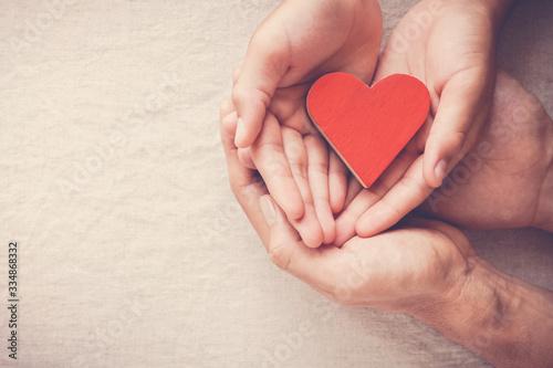 Obraz hands holding red heart, heart health, donation, volunteer charity, CSR responsibility,world heart day, world health day,world mental health day,foster home,  covid-19 coronavirus relief concept - fototapety do salonu