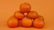 canvas print picture - Tangerines sur un arrière plan coloré de couleur orange