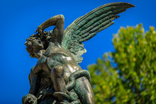Fountain Of The Fallen Angel Or Fuente Del Angel Caido In The Buen Retiro Park In Madrid, Spain Inaugurated In 1885