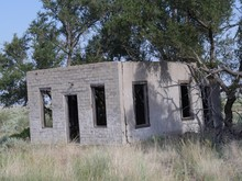 Concrete Shell Of A Building Left Abandoned At Glenrio Ghost Town, An Old Mining Town In New Mexico.