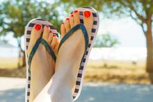 Female Feet Wearing Flip Flops...