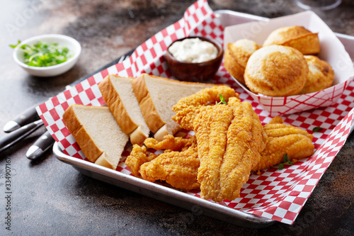 Fototapeta Fried catfish with cornbread dipped with buttermilk and seasoned with cornmeal, southern tradition obraz