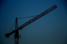 Crane On Background Of Blue Sky