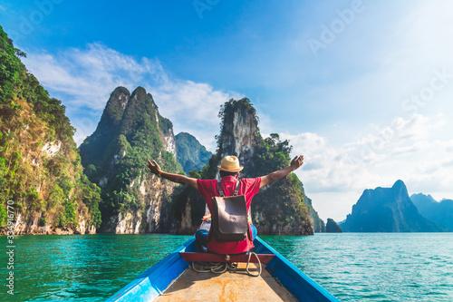 Man traveler on boat joy looking nature rock mountain island scenic landscape Kh Slika na platnu