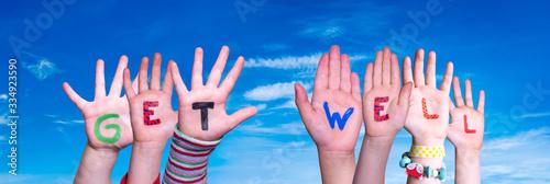 Valokuvatapetti Children Hands Building Colorful English Word Get Well
