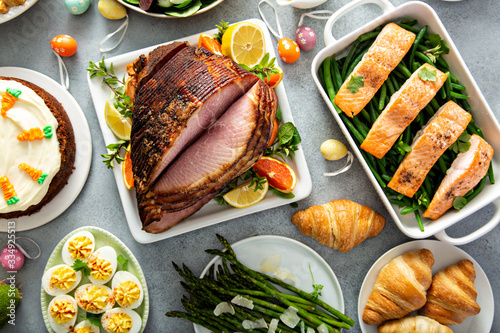 Fototapeta Big traditional Easter brunch with ham, salmon and carrot cake obraz