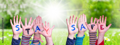 Leinwand Poster Kids Hands Holding Colorful English Word Stay Safe