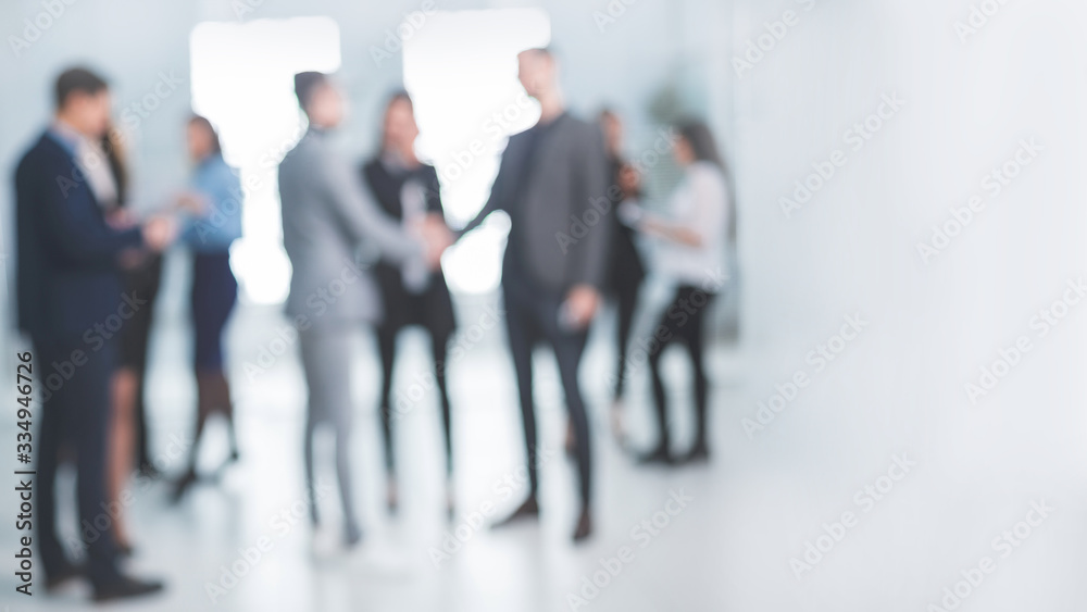 Fototapeta background image of a group of corporate employees in the office lobby