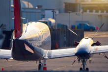 Small Commercial Airplane Or Private Jet Standing On An Airport Runway Ready For Take Off. Seen From Behind.