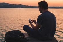 Man Using Mobile Internet On S...