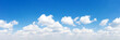 Leinwandbild Motiv Panorama Blue sky and white clouds. Bfluffy cloud in the blue sky background