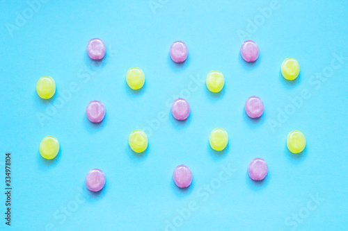 Multicolored candys on a colored background