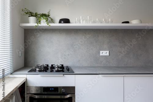 Fototapeta Stylish kitchen with gray countertop obraz