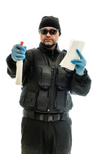 Concept Isolated Portrait On A White Background Man In Black Police Special Forces With Cleaning Products In Hands