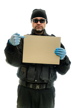 Concept Isolated Portrait On A White Background Man In Black Police Special Forces Uniform In Medical Gloves And A Banner In His Hands