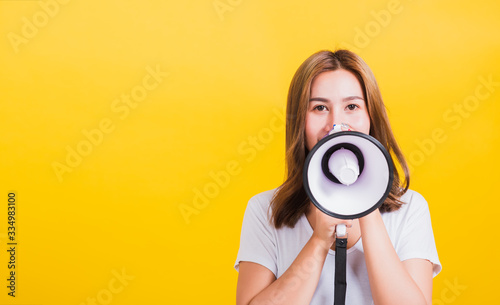 woman teen standing making announcement message shouting screaming in megaphone Canvas Print