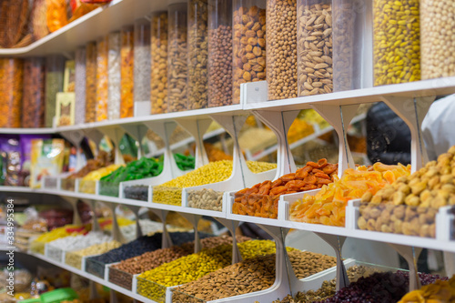 Fototapeta Market stall with various dried fruits and nuts obraz