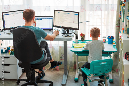 Fotografía Father with kid working from home during quarantine