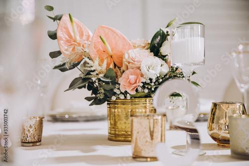 Fototapeta banquet tables decorated with flower arrangements obraz
