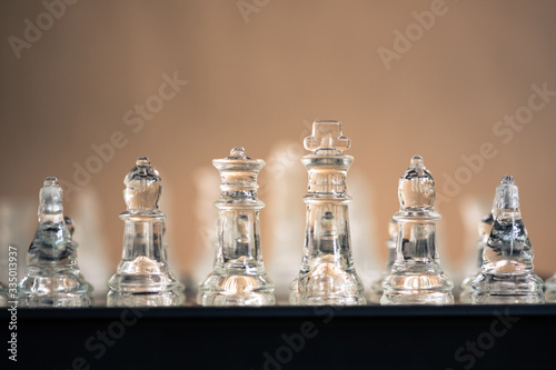 Fotomural Chess board game made of glass, business competitive concept