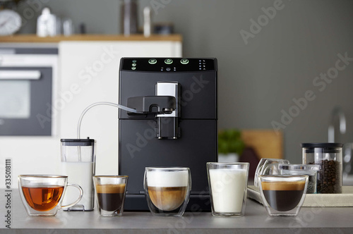 Canvastavla Automatic coffee machine and drinks in glass cups in the kitchen