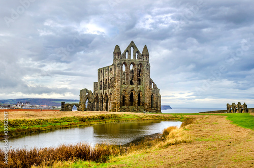 Photo Whitby Abby now derelict and formally a Benedictine abbey and is situated overlooking the sea on the East cliff above the fishing village and is used today by sailors as a landmark at the headland