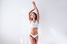 Young Fit Woman In White Linge...