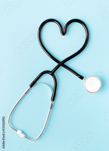 Stethoscope forming a heart on pastel blue background Canvas Print