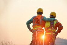 Engineers In Yellow Helmet And The Best Greetings With The Warm Handshake Team Visit The Website Modern Construction And Engineering Concepts Safety At Work In Production And Construction Sites