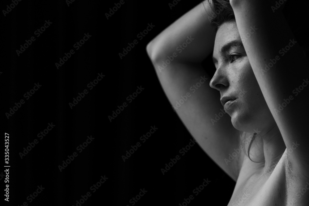 Fototapeta Black and white image of Ginger hair young white model with black background
