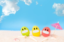 Colorful Eggs Wear Fabric Mask  On White Sand Beach Over Cloudy Sky Background, Image For Happy Easter Or Happy Weekend Concept.
