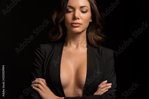 Photo sensual, confident girl in unbuttoned blazer posing with crossed arms isolated o