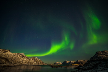 The polar arctic Northern lights hunting aurora borealis sky star in Norway travel photographer mountains. long shutter speed.
