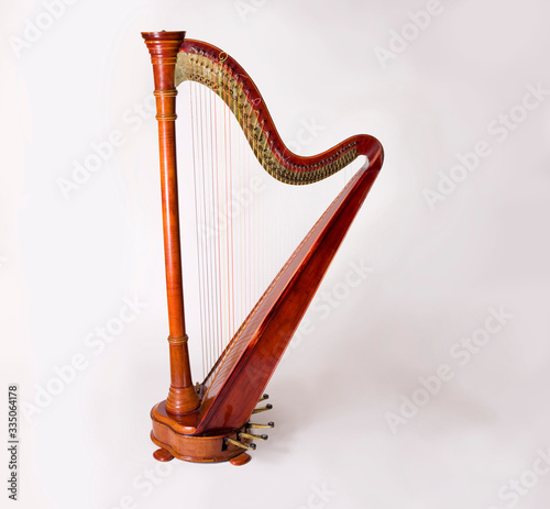 Fotografia, Obraz Harp isolated on white background silhouette shellak wooden mucical instrument