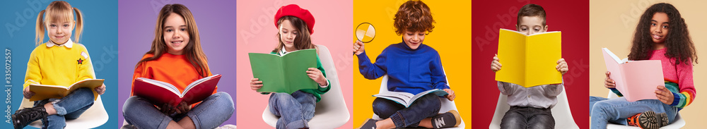 Fototapeta Happy pupils reading colorful books