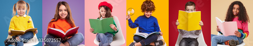Foto Happy pupils reading colorful books