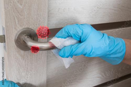 Obraz Wiping door knob with antibacterial disinfecting wipe for killing coronavirus. Coronavirus COVID-19 - fototapety do salonu