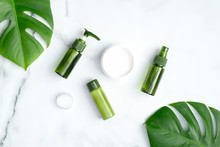 Set Of Natural Organic Cosmetics With Green Tropical Leaves. SPA Beauty Products For Skincare, Body And Hair Care. Flat Lay, Top View, Copy Space