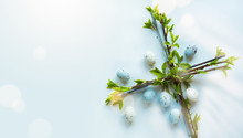 Easter Flower Cross And Easter Eggs On White Background; Christian Awakening Life Symbol