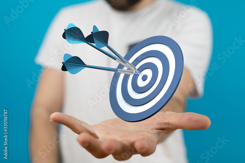 Foto dart target arrow hitting on bullseye which is the ultimate goal that everyone wants