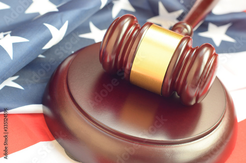 Fotografie, Tablou Justice mallet on United States flag in a courtroom during a judicial trial