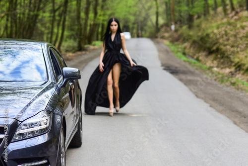 Sexy girl elegant dress at road Wallpaper Mural