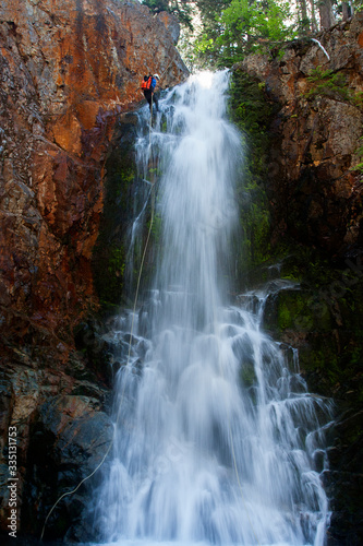 Rappeling down a waterfall, Canyoneering